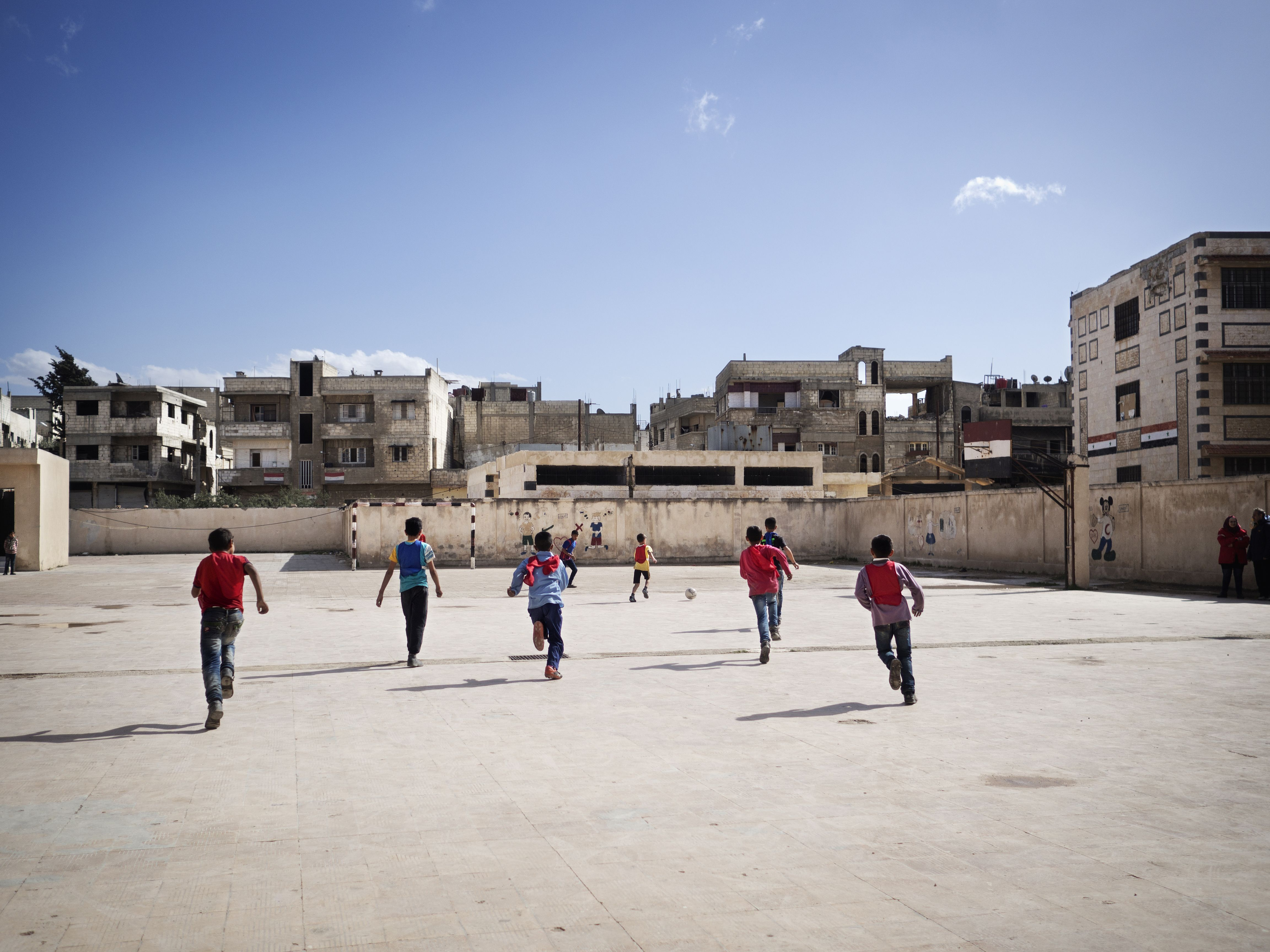 Afternoon activities for children. These children play football. PS-activities.